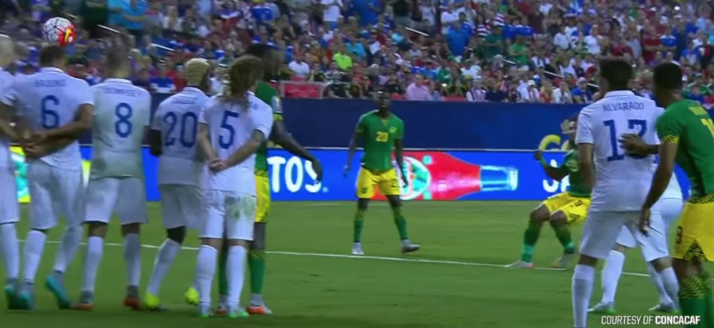 John Brooks shrinking under the free kick that scores for Jamaica's second goal.