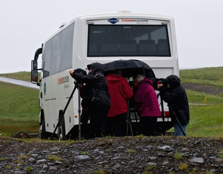 Intrepid photographers try to ignore the rain and keep shooting  (photo:  Carol Soderlund)