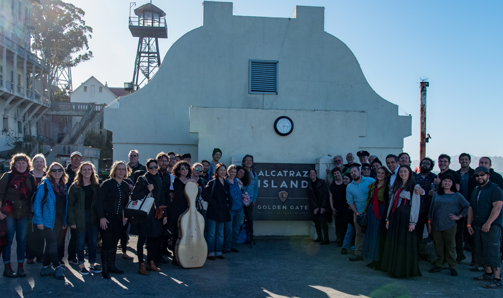 The cast and crew of  Vireo  at the dock on Alcatraz, ready to begin work.