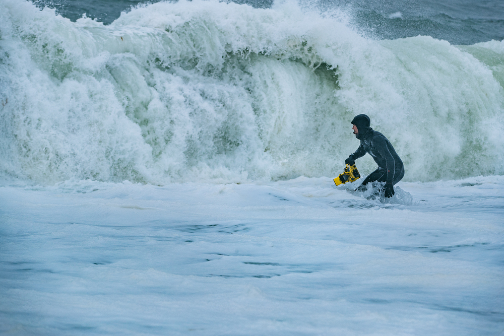 Justin heads in after a rough day in cold Alaskan waters photographing the Rescue Swimmers in high surf ops.