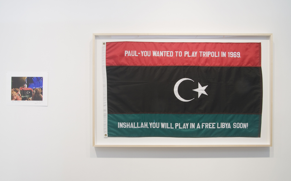 Michael Rakowitz   Inshallah at Sabratha (The Breakup Series)  , 2011-2012   flag (42 x 66.5 inches) video (1min29sec) photograph (13 x 16.15 inches)
