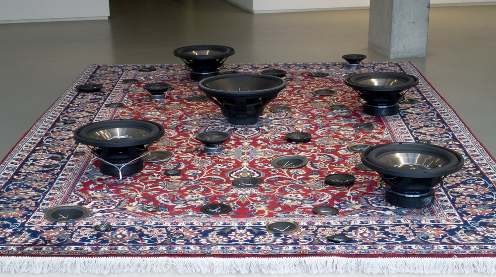 Mounir Fatmi   Oriental Accident , 2011 sound system, speakers, carpet on wooden structure  19.69 x 132.28 x 88.98 inches 50 x 336 x 226 cm