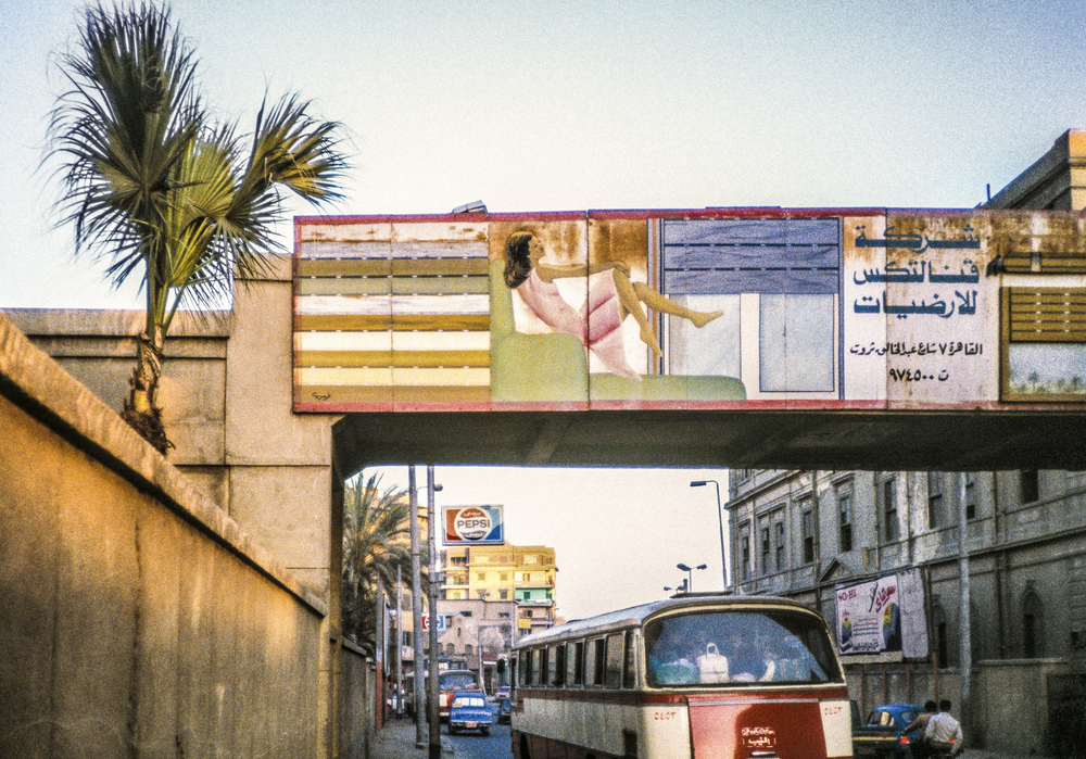 Lucien Samaha   Reclining on the Overpass (Cairo Billboards) , 1984, printed 2014 archival pigment print 30 x 44 inches 76.2 x 111.8 cm