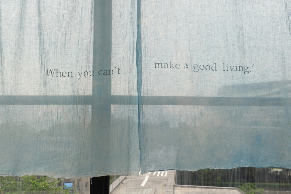 Lee Kit   Popping Up  Installation view at Hong Kong Arts Centre, 2010 20 pieces of hand-painted cloth with text, used as a window curtain and tablecloth