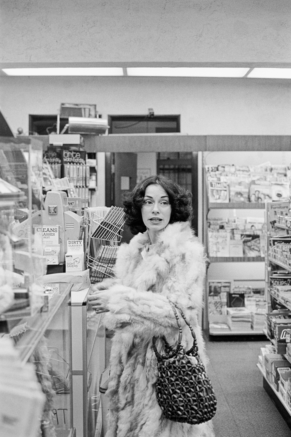 Lucien Samaha   Marianne in the Drugstore, Kansas City (The Flight Attendant Years) , 1978, printed 2013 archival pigment print 17.5 x 12.5 inches 44.5 x 31.8 cm