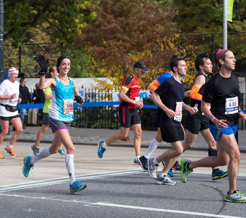 Sarah, still smiling, at mile 22 of the NYC Marathon (photo by Bruno Eicher)
