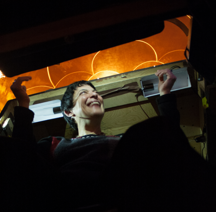 a view of Donna Racik in the prompter's box; photo credit, Stephanie Mortimore