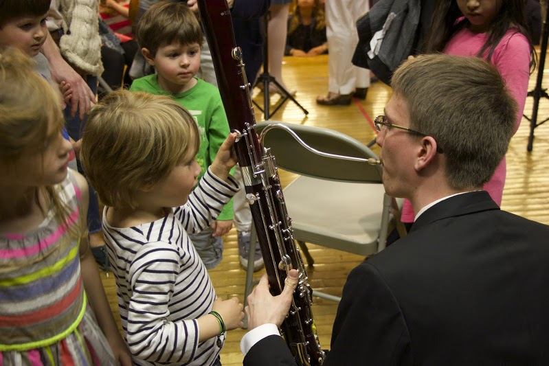 Bassoonist Billy Short demonstrating the functions of different keys (Photo by Rob Knopper)