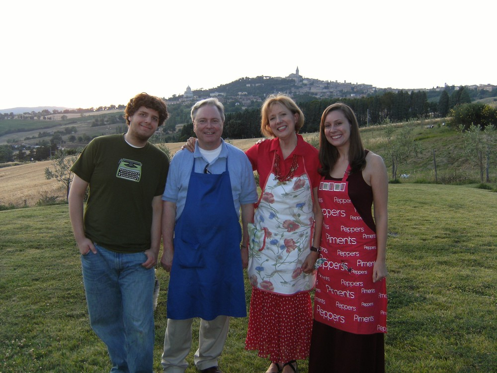 Mary Ann and her family after a cooking class, with the town of Todi in the background