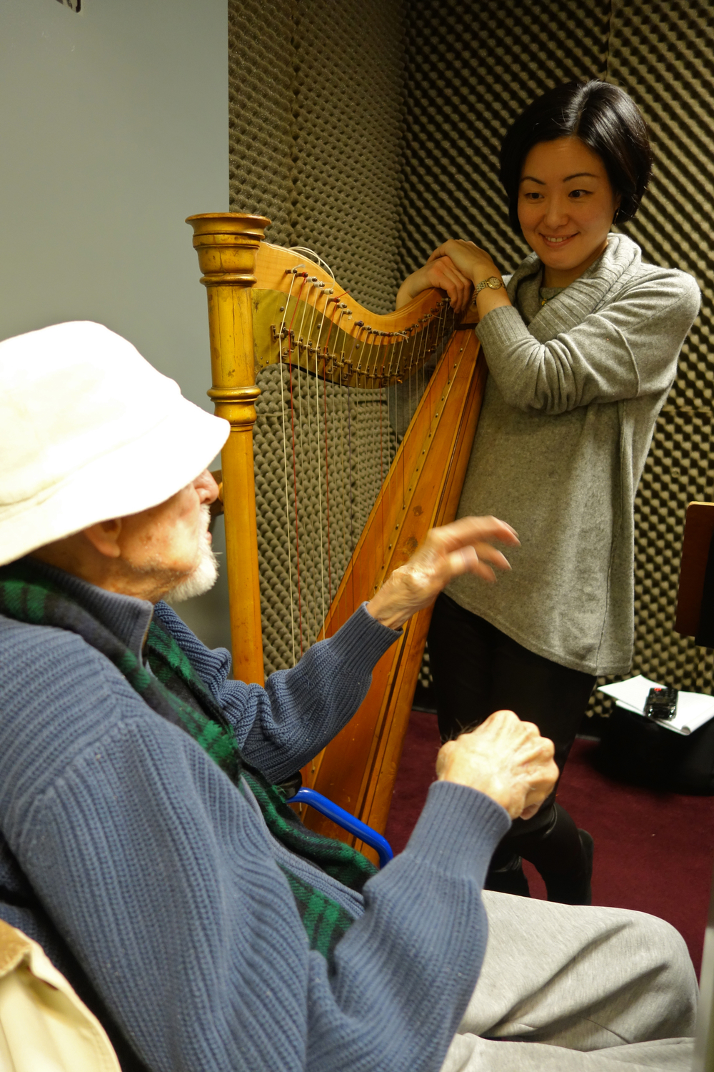 Retired Principal Harpist Reinhardt Elster and current Met harpist Mariko Anraku.