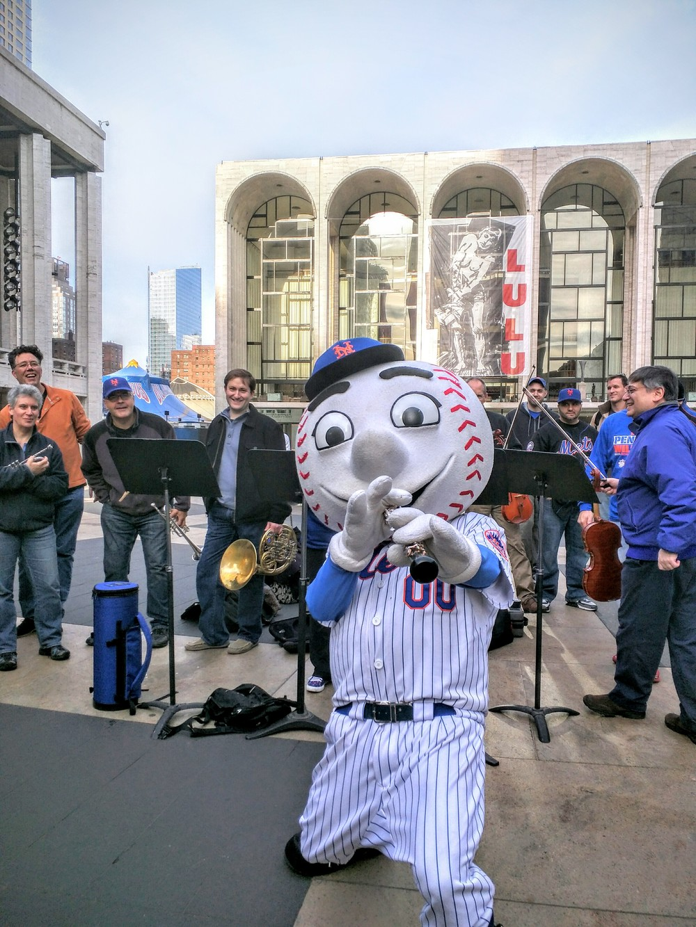 Mr. Met tries his hand at the oboe. Photo by Billy Hunter