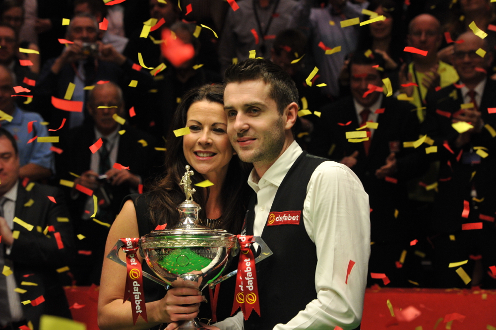 Mark Selby and his wife Vikki celebrate after his winning clearance made him world champion