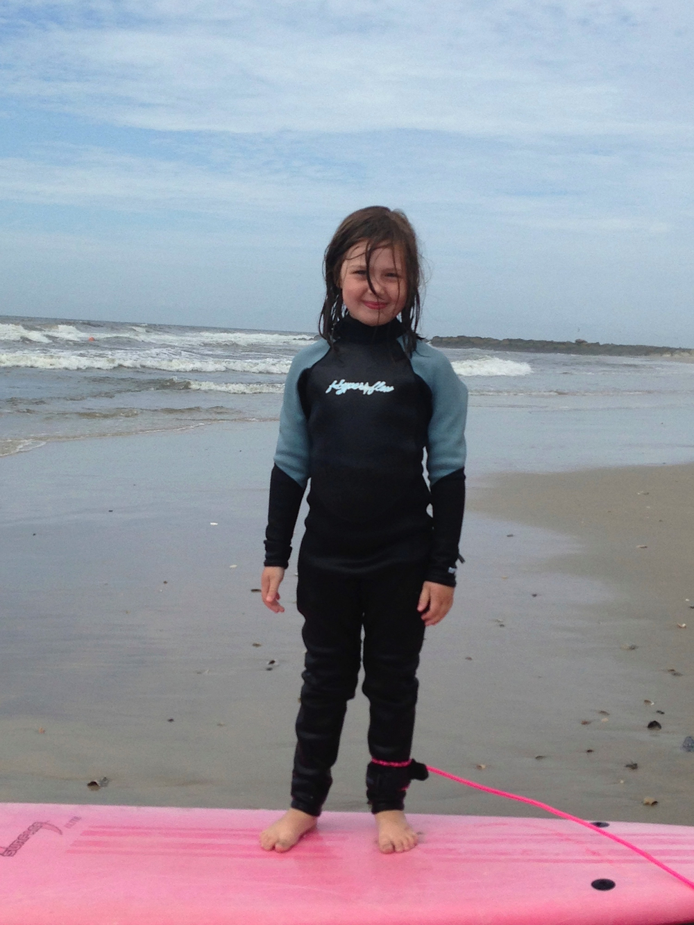 Image of young girl, 2013 Surf2Live, Long Beach, NY Summer Surf Camp.