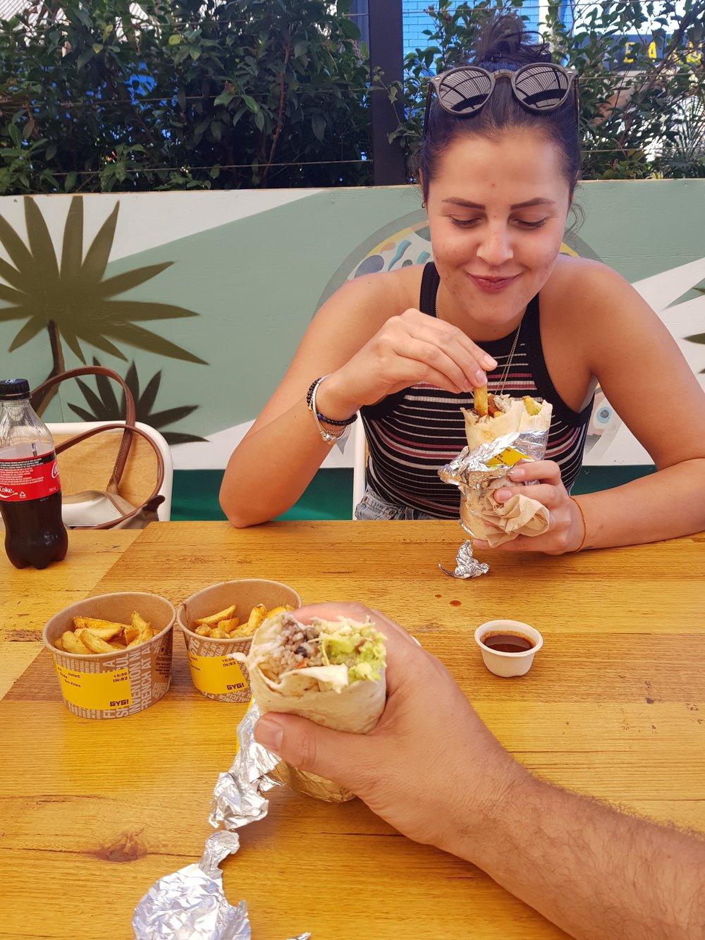 Me putting fries in my Burrito...  Guzmen & Gomez, Byron Bay