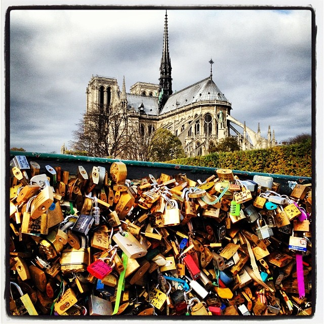 christopherdickey :     Lovers' locks and Notre Dame in Paris, France, just now