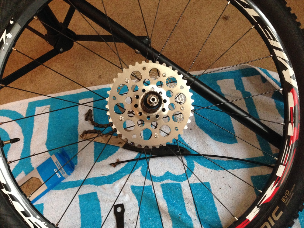 Remove your standard cassette using your chain whip and cassette tool. Slide on your new sprocket.