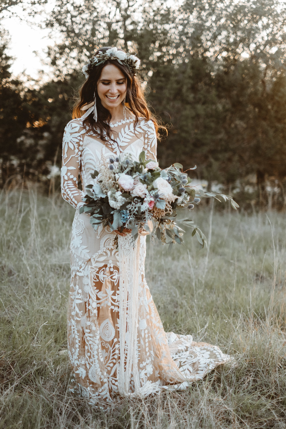 Bohemian style, wildflower inspired bridal and bridesmaid bouquets with white peonies, protea, eucalyptus, anemone, ranunculus at Vista West Ranch. Petal Pushers floral event design studio located in Dripping Springs, Texas.