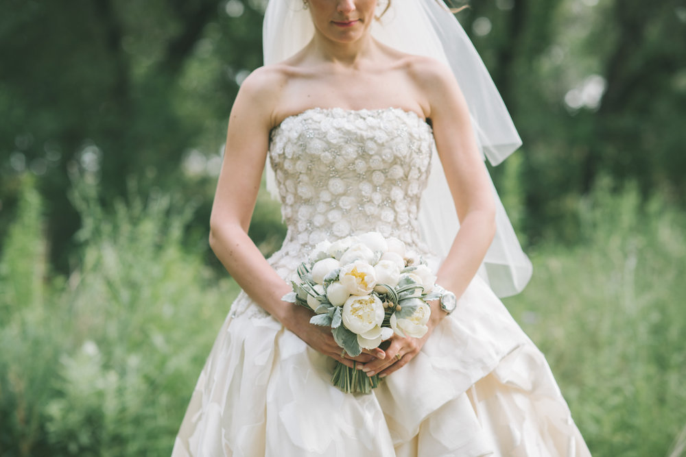 Elegant white peony flower bulb bridal bouquet at Vista West Ranch. Petal Pushers floral event design studio located in Dripping Springs, Texas.