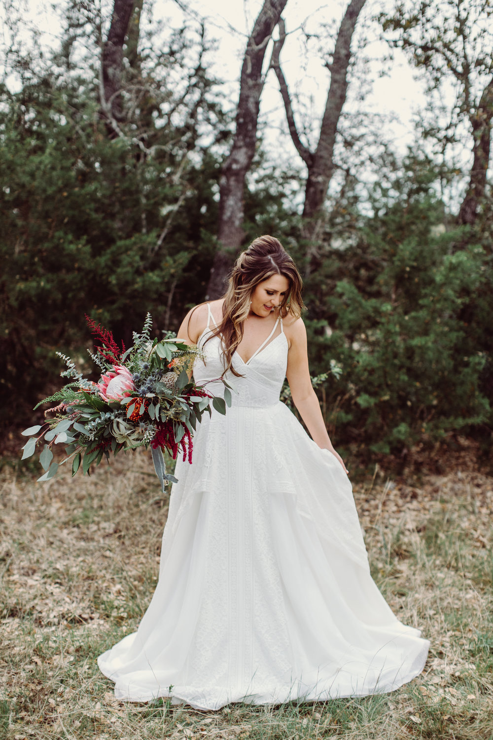 Boho wedding bride bouquets with eucalyptus, protea, thistle, astilbe Petal Pushers floral event design studio located in Dripping Springs, Texas.