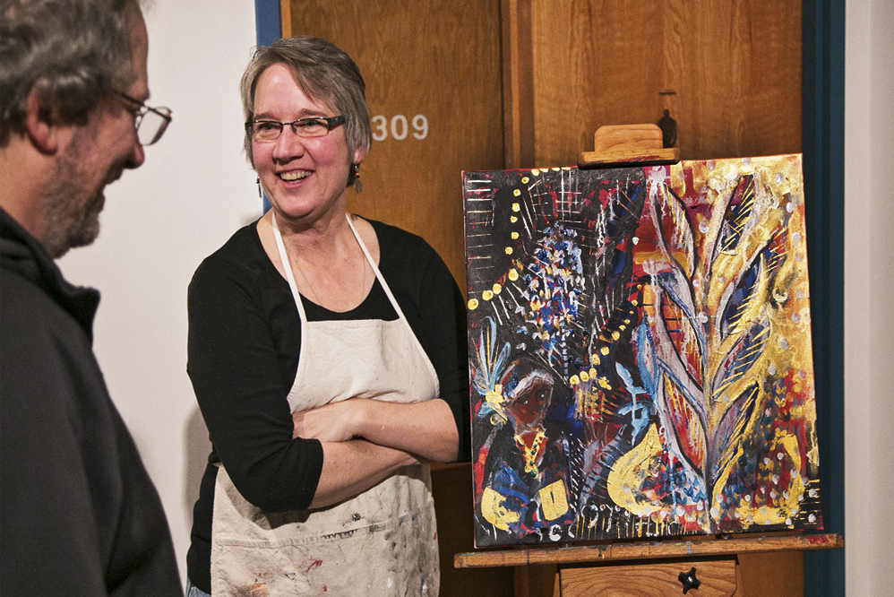 Jamie Kalvestran  with the finished painting after a 2hr live-painting session. Photo Credit:  Patrick Clancy