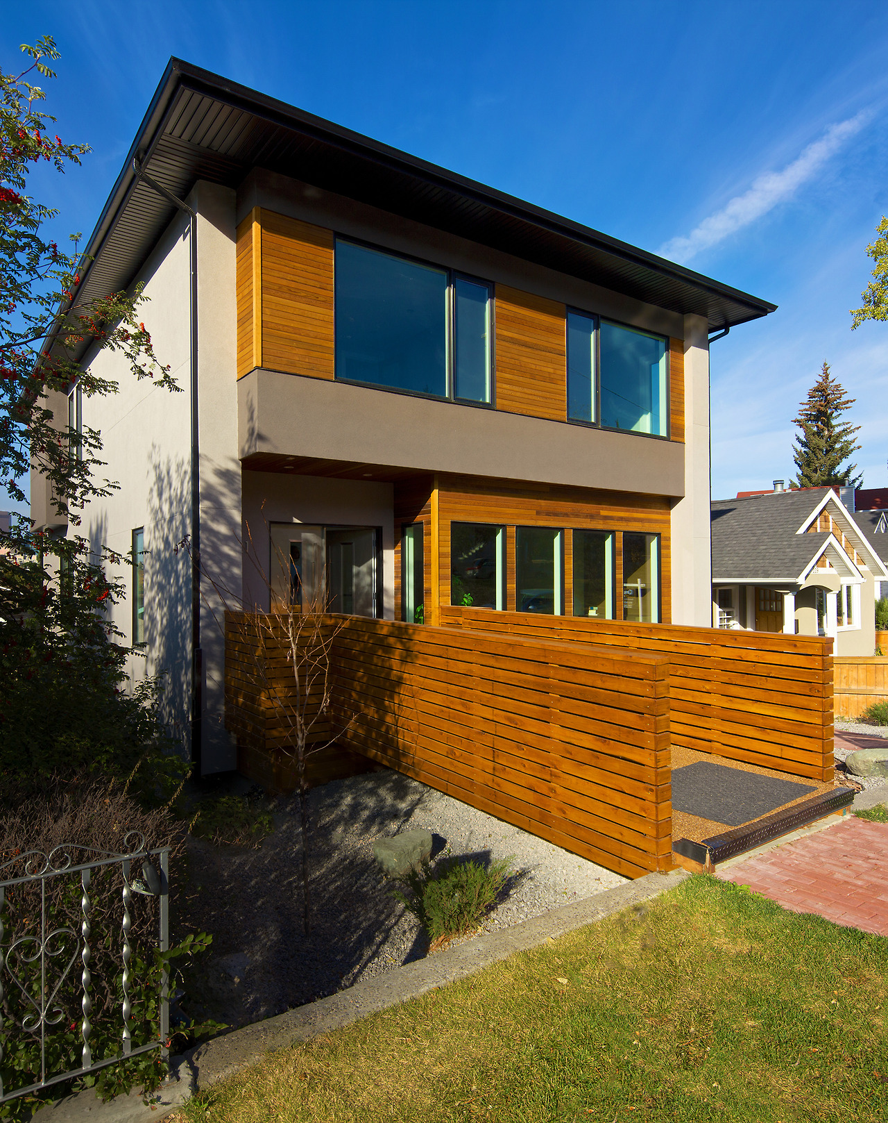 This Bridgeland house was on a fairly steep front-to-back sloping lot, and had an existing retaining wall at the front of the property. Our solution, of course, was a bridge from the sidewalk to the front door.