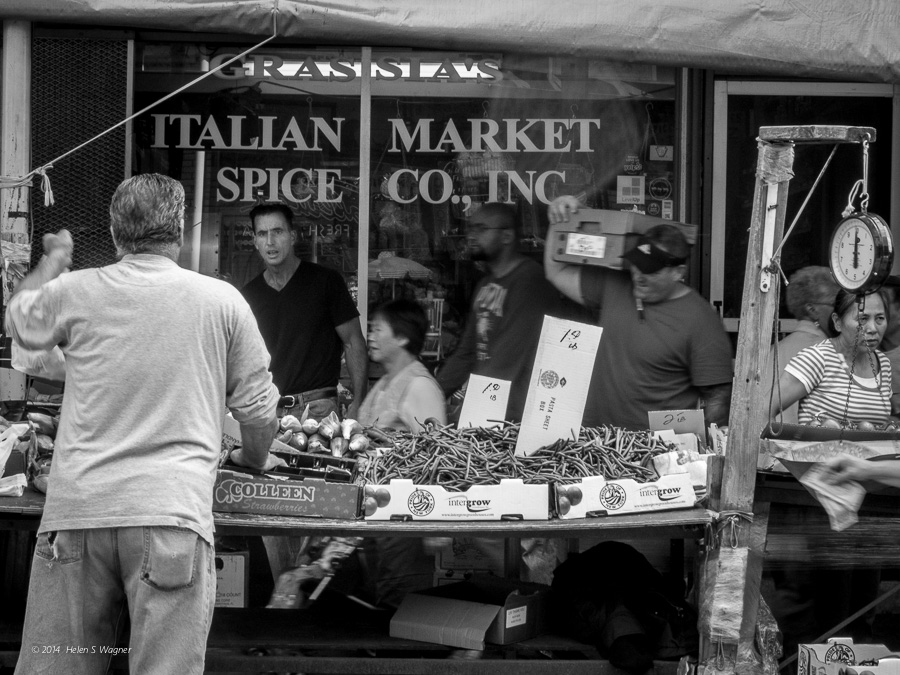 There's always activity surrounding the many vendors at Philadelphia's Italian Market.