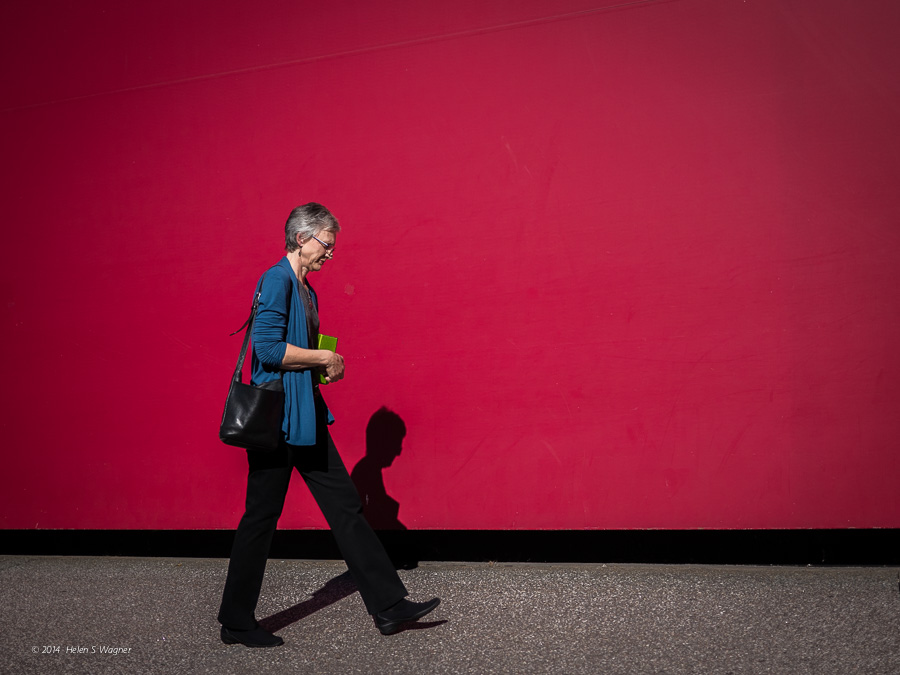A red wall in front of the Guthrie Theater provided a great backdrop to make an image of a woman passing by.