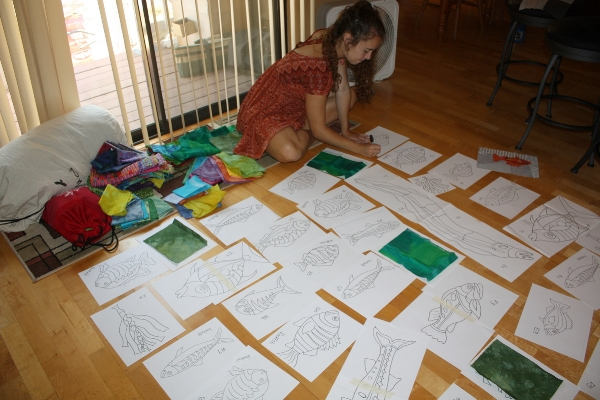 Lucy helping with the layout of the many fish patterns