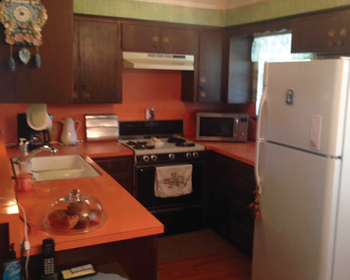 I couldn't wait to show you the pièce de résistance, so here it is. The kitchen in all its orange formica glory. Mind you, this home was built in the 60's...
