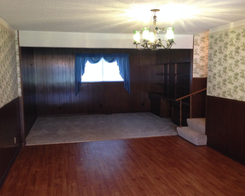 After closing, I took a few pictures of the home after it was vacant. Here's the living/dining room. You can get a better feel for the wood paneling and the wallpaper. I quickly discovered that there was not just one but two layers of wallpaper.