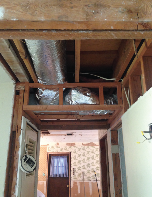 One section of the ductwork couldn't be recessed into the floor joists, but I was able to add in three additional inches to the ceiling height there. Every little bit helps!