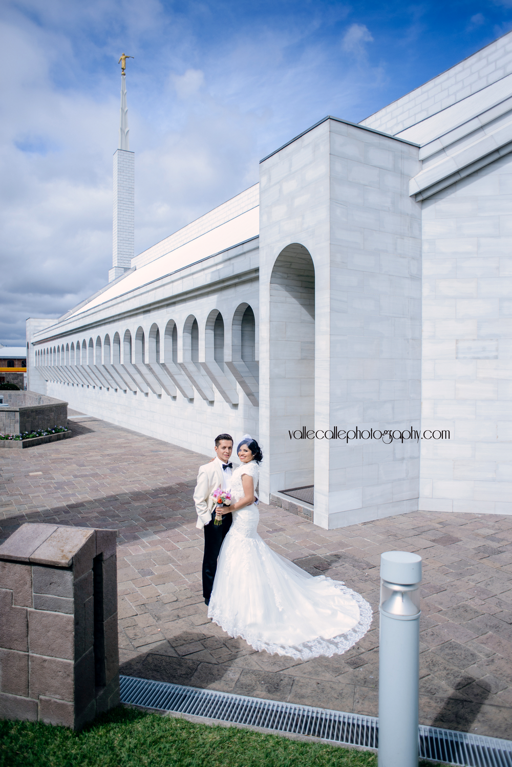 The most challenging part about this photo??? Trying to keep random people (not guests, but RANDOM people lol) from photobombing this image +_+, but the final image was so worth it! I've seen other photographer's take of bride & groom's photo in front of the temple, but I decided to give it a twist... and I like it!!!