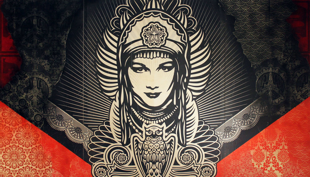 SIDE ONE   Shepard Fairey   Peace Goddess Mural , 2011 Mixed media on double-sided, three-part, on wood panel.  Peace Goddess image on front, Dove image on the reverse Unsigned 8 feet x 14 feet Provenance: produced for indoor exhibition at Merchandise Mart Chicago, IL, 2011 Estimate: $25,000/$35,000