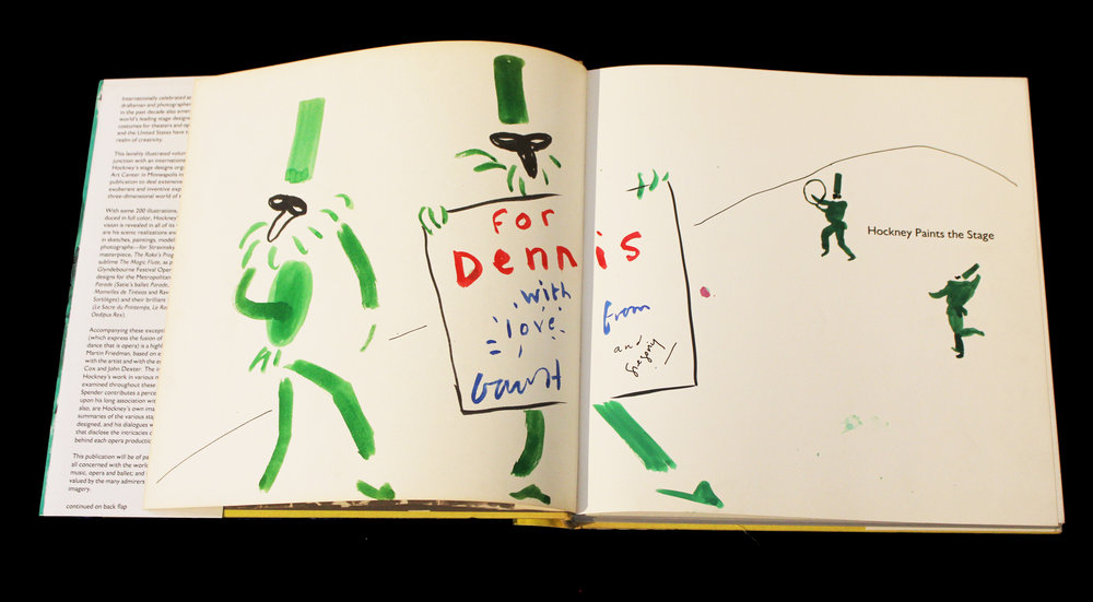 "David Hockney    Hockney Paints the Stage , 1983 Unique pen and ink hand drawing in colors by David Hockney on left and right title pages within hardback monograph ""Hockney Paints the Stage"" Signed by both David Hockney and Hockney's partner Gregory, dedicated ""For Dennis"" Drawing: 10 x 12 inches; Book: 10.5 x 10.5 inches Provenance: Gifted to Dennis Purcell from the Artist, from thence gifted to present owner Estimate: $3,000/$4,000"