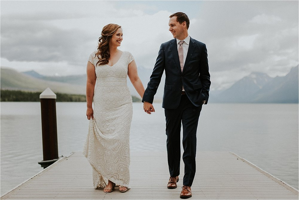 glacier national park walking bride and groom.jpg