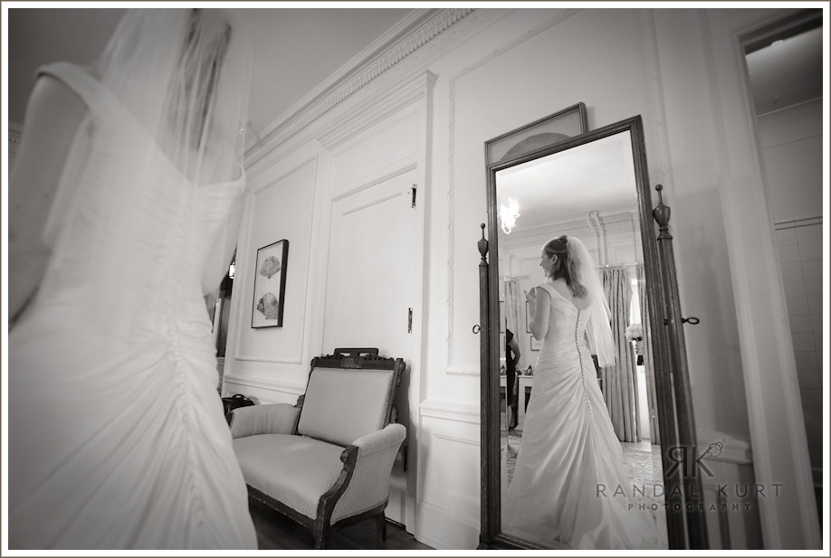 The bride in her dress - just getting ready for the finishing touches.