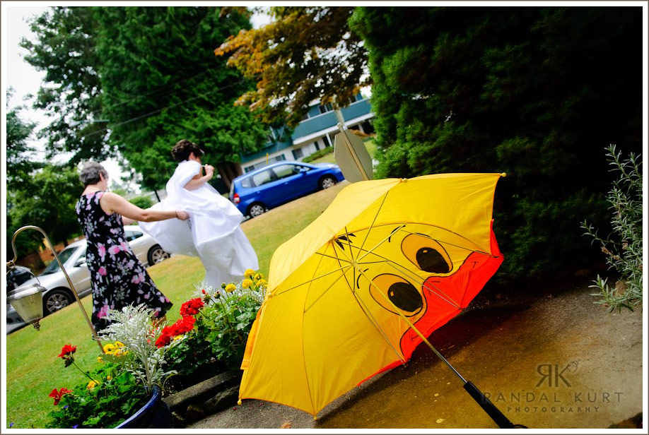 The umbrella says it all on Sara and Rich's day