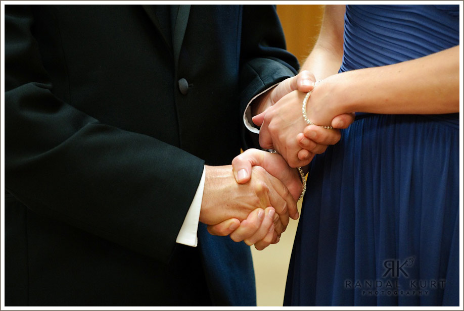 Holding hands down the wedding aisle