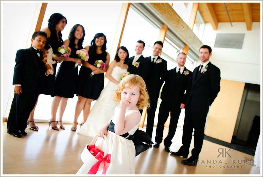 The bridal party wait with their ring bearer and flower girl