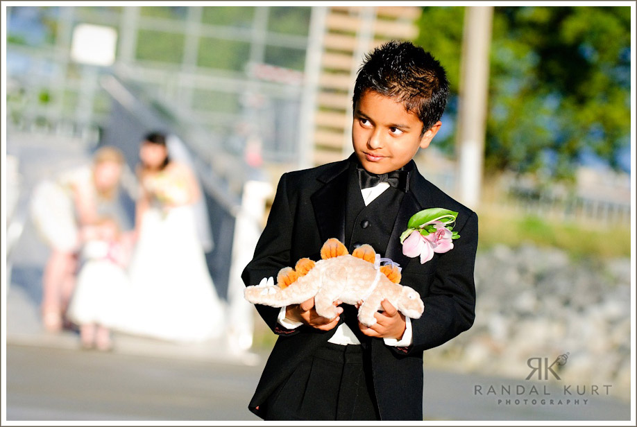 The ring bearer heads down at the start of the ceremony