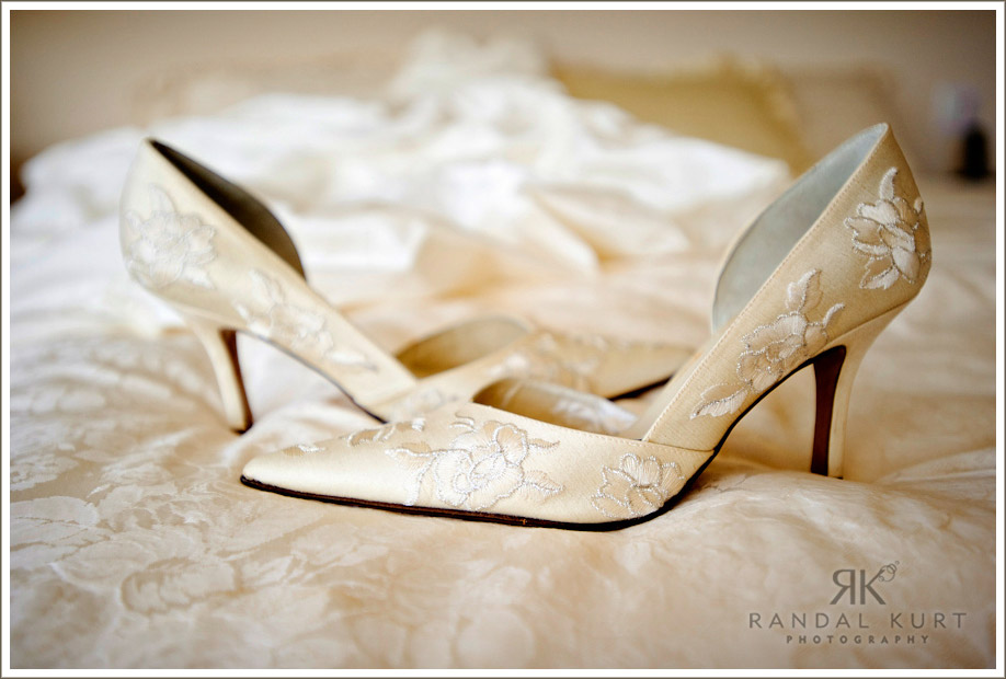 Michelle's wedding shoes on the bed