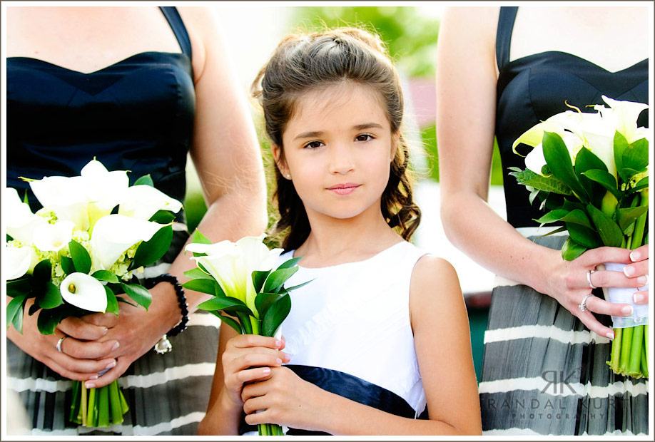 Matthew and Michelle's flower girl looks on