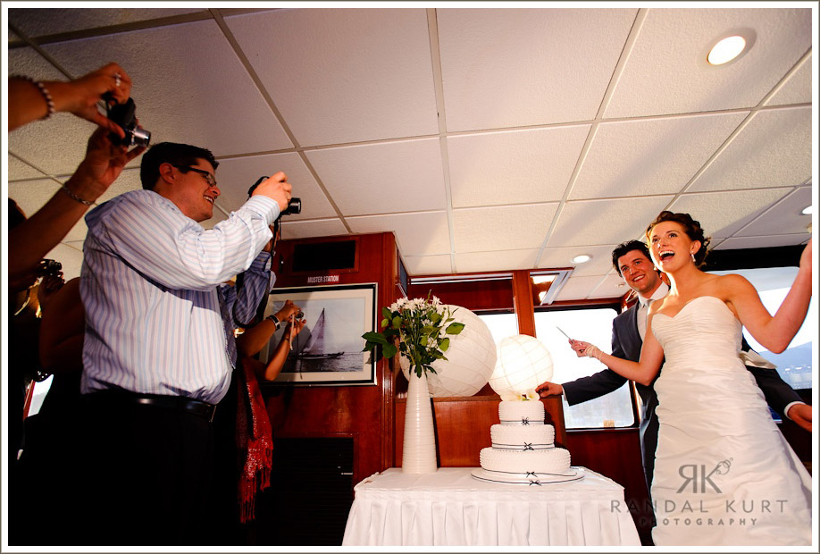 Michelle and Matthew cut their wedding cake