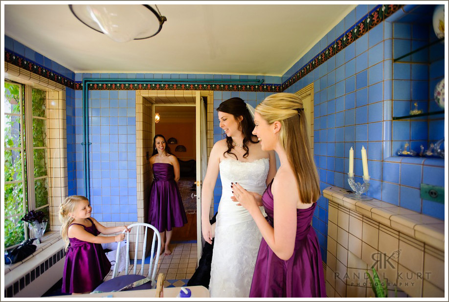 The bride prepares for her day with help from her mom and bridesmaids