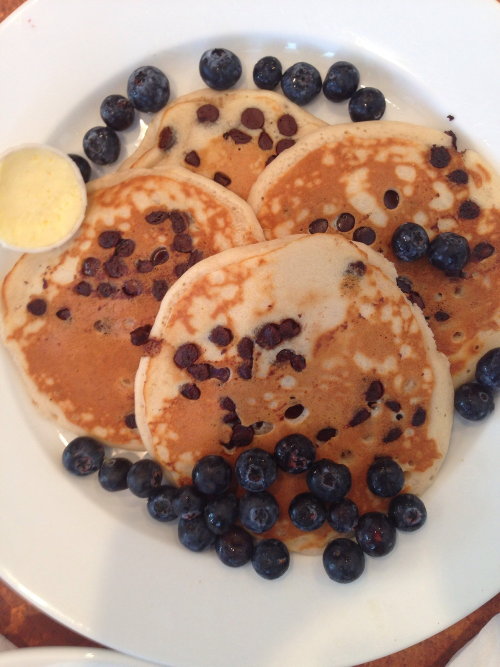 Vegan chocolate chip pancakes with fresh blueberries