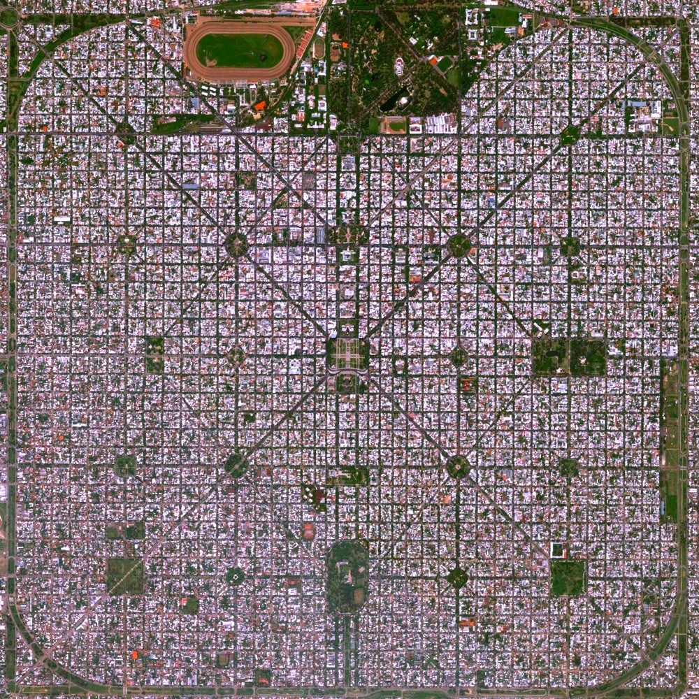 "5/3/2015   La Plata   Buenos, Aires, Argentina  34°55′16″S 57°57′16″W     The planned city of La Plata, the capital city of the Province of Buenos Aires, is characterized by its strict grid pattern. At the 1889 World's Fair in Paris, the new city was awarded two gold medals for the ""City of the Future"" and ""Better performance built."""
