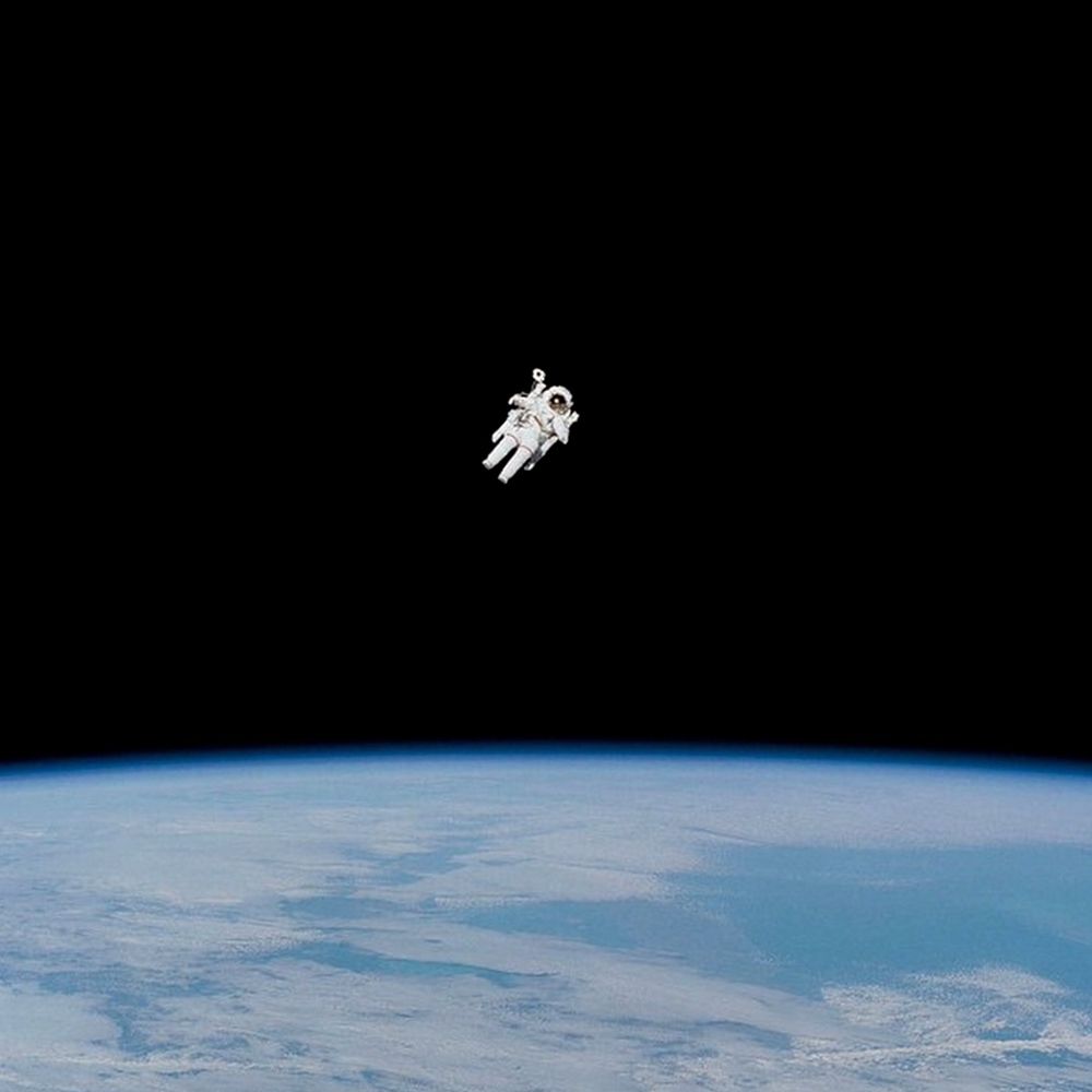 We are definitely feeling the Overview Effect in this photograph taken of Bruce McCandless II by his fellow crewmembers aboard the Earth-orbiting Space Shuttle Challenger on February 7, 1984. At this stage in his mission, he was approaching his maximum distance from the vehicle. The first American to conduct a spacewalk was astronaut Edward H. White II when he floated into the vastness of space on June 3, 1965. Credit: NASA