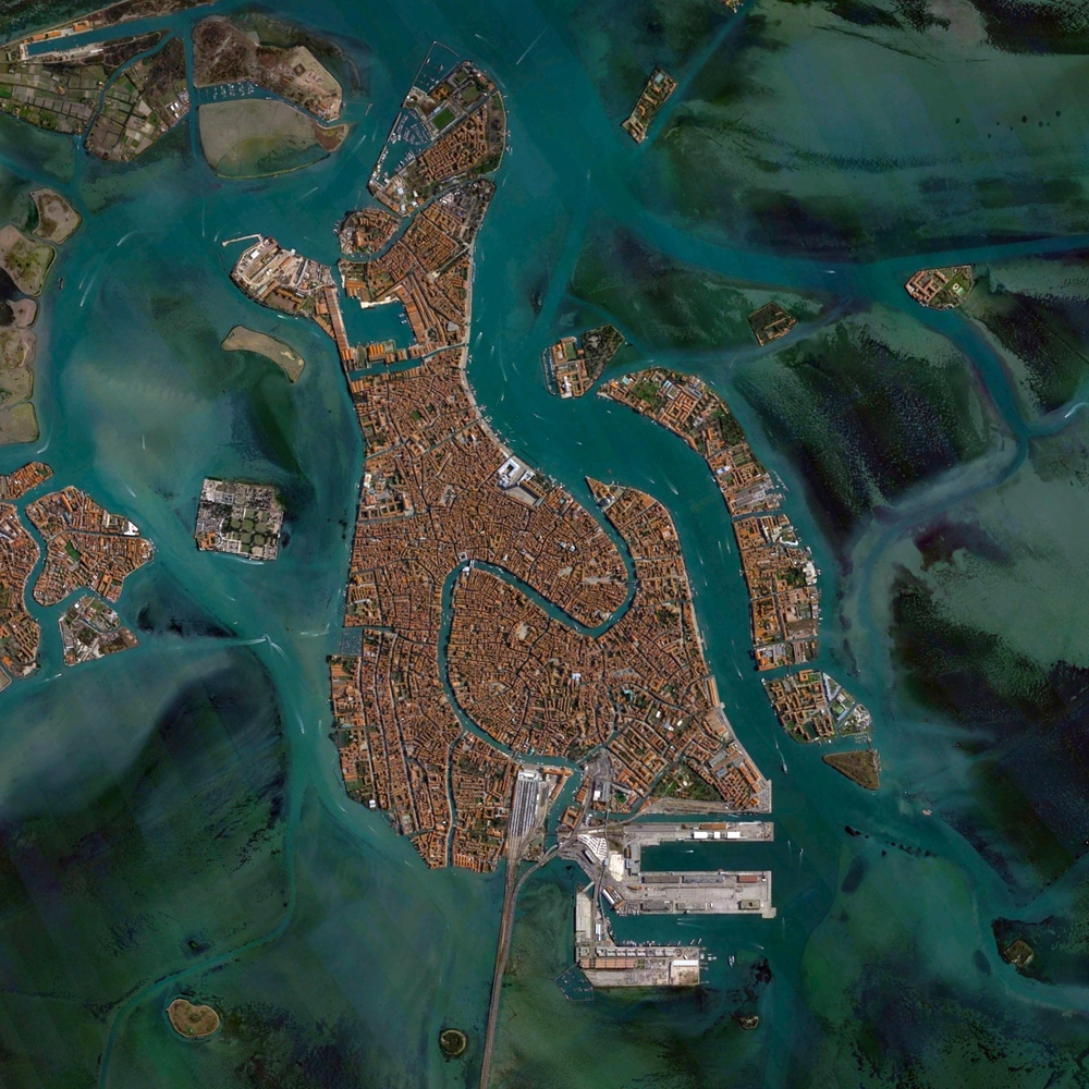 6/10/2015 Venice Venice, Italy 45°26′15″N 12°20′9″E   Venice, Italy is situated upon 118 small islands that are separated by canals and linked by bridges. With tide waters expected to rise to perilous levels in the coming decades, the city has constructed 78 giant steel gates across the three inlets through which water from the Adriatic could surge into Venice's lagoon. The panels – which weigh 300-tons and are 92ft wide and 65ft high - are fixed to massive concrete bases dug into the seabed.