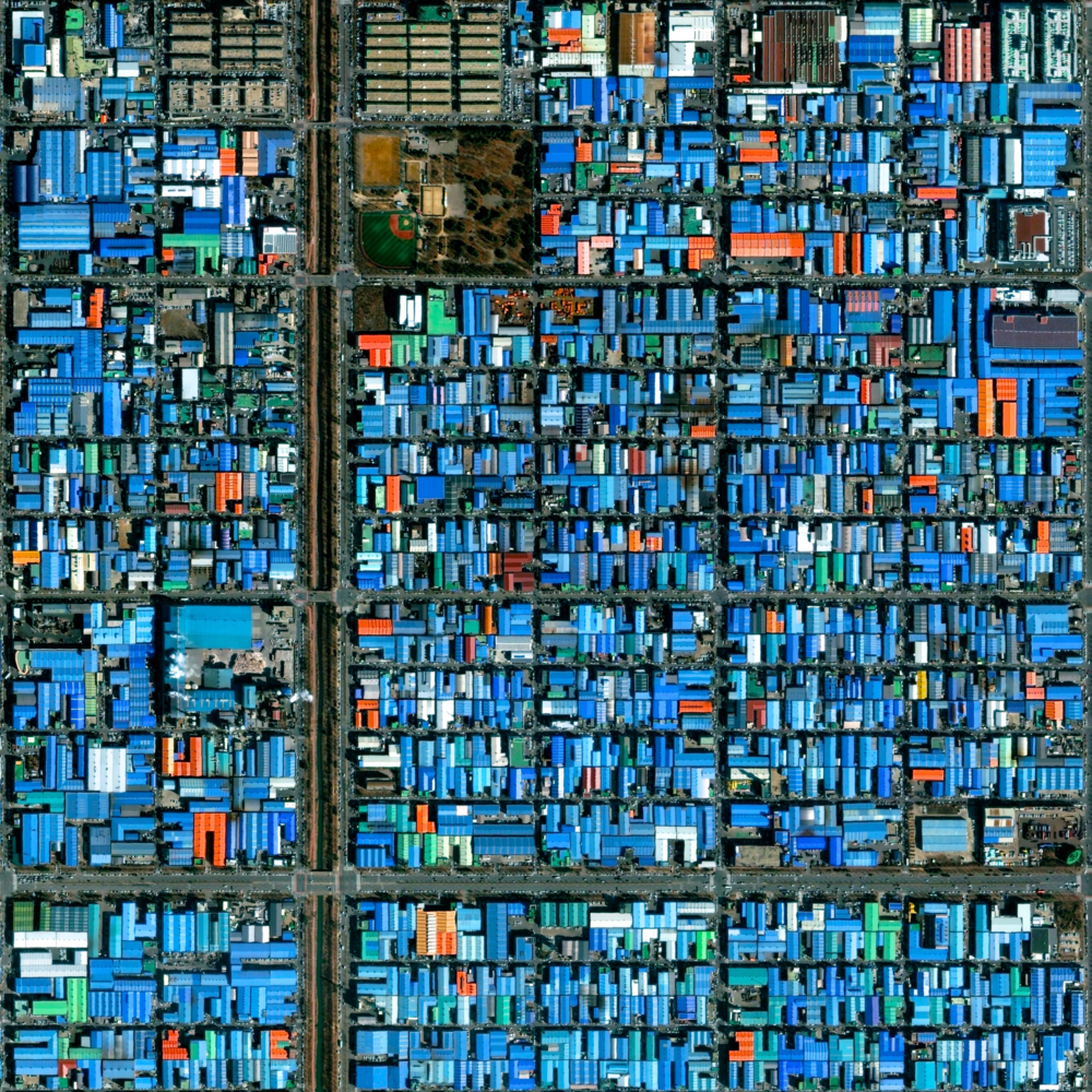 "We're doing a Sunday Overview Giveaway over on our Instagram feed today.  Simply tag three friends in the comments there to be entered to win your choice of either a 12x12"" or 12x16"" print of Ansan, South Korea. In this Overview, we see the blue, aluminum roofs that fill the industrial sector of the city. This material is frequently used because of its low cost and durability."
