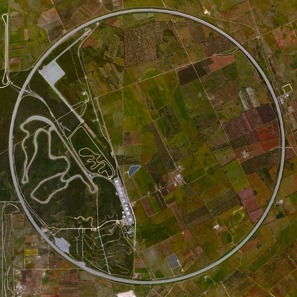 "6/23/2015 Nardò Ring Nardò, Italy 40°19′38″N 17°49′34″E   The Nardò Ring is a high speed, 7.8 mile long, circular test track in Nardò, Italy. Each of the ring's four lanes has a determined ""neutral speed"" and is banked in such a manner that one can drive as if the road were straight."